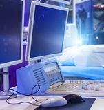 Multiple monitors and control panel of medical equipment for cancer treatment. Medical equipment for the treatment of cancer royalty free stock photos
