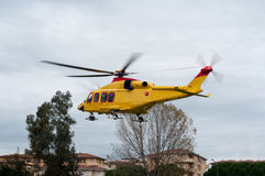 Medical Evacuation. Helicopter taking off from urban zone Stock Image
