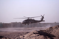 Medical Evacuation Helicopter in Iraq. A Medical Evacuation Blackhawk Helicopter takes off from a forward operating base with wounded soulders to get air lifted Royalty Free Stock Photography