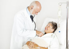 Medical Exam from Handsome Doctor Royalty Free Stock Photography