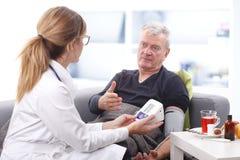 Medical exam at nursing home Stock Photos