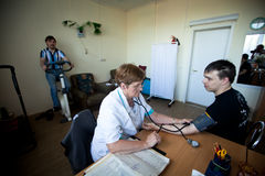 Medical examination of disabled Stock Image