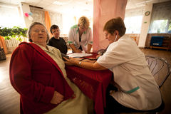 Medical examination of disabled Stock Images