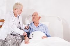 Medical examination of senior man Stock Photo