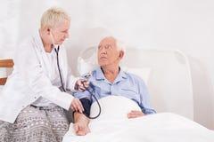 Medical examination of senior man Stock Photo