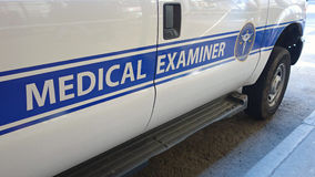 Medical Examiner Van. A white ban with the logo of the Medical Examiner of the City of New York royalty free stock photo
