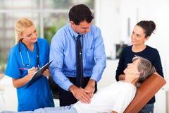 Medical examining senior Stock Photos