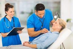 Medical examining senior patient Royalty Free Stock Photos