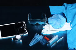 Medical experiment tools set up arrangement for background shoot. Ing with studio lighting, copy space, digital tablet, needle, hygiene, glasses Stock Photos
