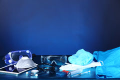 Medical experiment tools set up arrangement for background shoot. Ing with studio lighting, copy space, digital tablet, needle, hygiene, glasses Stock Images