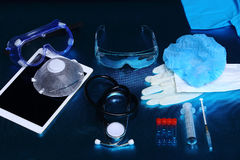 Medical experiment tools set up arrangement for background shoot. Ing with studio lighting, copy space, digital tablet, needle, hygiene, glasses Royalty Free Stock Images