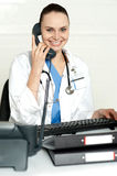 Medical expert communicating on phone Stock Photos