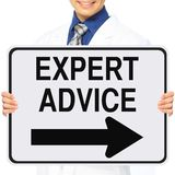 Medical Expert. A man wearing a lab coat holding a modified one way sign indicating Expert Advice stock photos