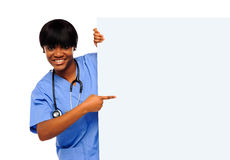 Medical expert pointing towards placard Royalty Free Stock Photos