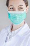 Medical face mask. Portrait of a female surgeon, with face mask Royalty Free Stock Image