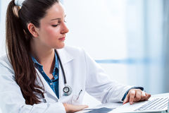 Medical female doctor reviewing results on laptop. Stock Photography