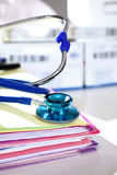 Medical files with stethoscope Stock Photos