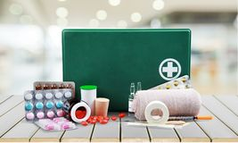 First aid kit  with medical supplies on light Royalty Free Stock Image