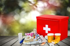 First aid kit  with medical supplies on light. Medical first aid first aid kit medical supplies white background healthcare and medicine still life Stock Image