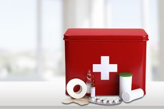 First aid kit  with medical supplies on light. Medical first aid first aid kit medical supplies white background healthcare and medicine still life Stock Photography