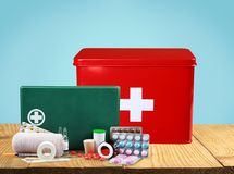 First aid kit with medical supplies on wooden. Medical first aid first aid kit medical supplies white background healthcare and medicine still life Stock Images