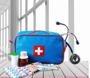 First aid kit with medical supplies on wooden. Medical first aid first aid kit medical supplies white background healthcare and medicine still life Royalty Free Stock Images