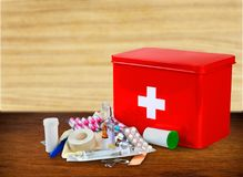 First aid kit with medical supplies on wooden. Medical first aid first aid kit medical supplies white background healthcare and medicine still life Royalty Free Stock Image