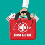 Medical first aid kit with pills and thermometer. Medical first aid kit with different pills, phonendoscope, syringe and thermometer. Healthcare, hospital and Royalty Free Stock Photography