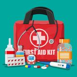 Medical first aid kit with pills and devices. Medical first aid kit with different pills, phonendoscope and thermometer. Healthcare, hospital and medical Stock Images