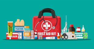 Medical first aid kit with pills and devices. Medical first aid kit with different pills, phonendoscope and thermometer. Healthcare, hospital and medical Stock Image