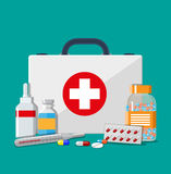 Medical first aid kit with pills and thermometer. Medical first aid kit with different pills and thermometer, healthcare. Vector illustration in flat style Stock Photography