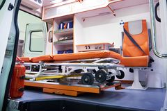 Medical wheeled stretcher for patients in ambulance. Medical foldable wheeled stretcher for patients in an ambulance Royalty Free Stock Images