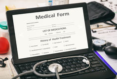 Medical form on a doctor`s computer screen stock images