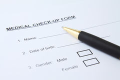 Medical form with pen. Close up of patient's medical check-up form stock photo