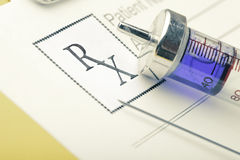 Medical form RX and syringe Royalty Free Stock Photos