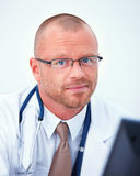 Medical - Friendly doctor looking at you Royalty Free Stock Images