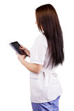 Medical girl worker with electronic tablet in hands Royalty Free Stock Photo