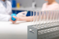 Medical glass tubes for blood test at laboratory stock photo