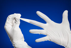 Medical Gloves. Stretching medical gloves on a blue background stock photo