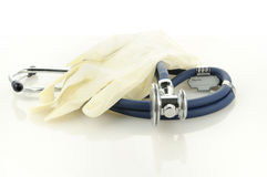 Medical gloves and phonendoscope. Medical gloves and blu phonendoscope for patients examination Stock Photography