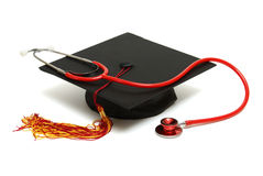 Medical Graduate. An isolated mortarboard and stethoscope to conceptualize the medical graduate Stock Image