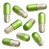 Medical green capsule with granules Royalty Free Stock Images