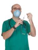Medical green uniforms preparing a syringe Stock Images