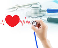 Medical, hand holding stethoscope and document Stock Images