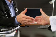 Medical and health care concept,Doctor and patient shaking hands Stock Photos