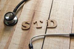 Medical and Health Care Concept, STD Sexually Transmitted Disease. Medical and health care words writing typography lettering concept, STD Sexually Transmitted royalty free stock images