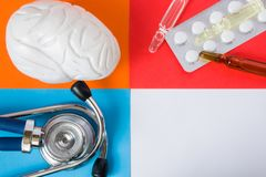 Medical or health care design concept photo-organ brain, diagnostic medical tool stethoscope and medications pills and vials stock photo