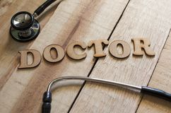 Medical and Health Care Concept, Doctor. Medical and health care words writing typography lettering concept, Doctor royalty free stock photos