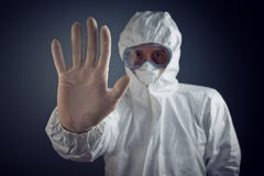 Medical Health Care Worker Showing Stop Sign. With hand, entrance is forbidden in quarantine zone stock images