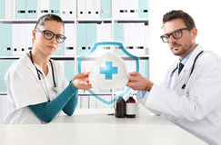 Medical health insurance concept, doctors hands with helmet Royalty Free Stock Photos